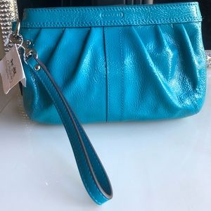 Coach patent leather turquoise blue large wristlet